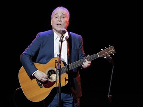 In a Sept. 22, 2016 file photo, musician Paul Simon performs during the Global Citizen Festival, in New York.