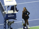 Serena Williams argues with the chair umpire during the women's final of the U.S. Open at the USTA Billie Jean King National Tennis Center, in New York, Saturday, Sept. 8, 2018.