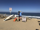 Two people look out at the shore after a reported shark attack at Newcomb Hollow Beach in Wellfleet, Mass,  on Saturday, Sept. 15, 2018.