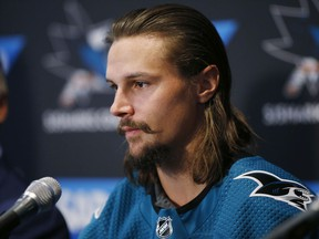 Newly acquired San Jose Sharks defenseman Erik Karlsson speaks to the media during a news conference in San Jose, Calif., Wednesday, Sept. 19, 2018.