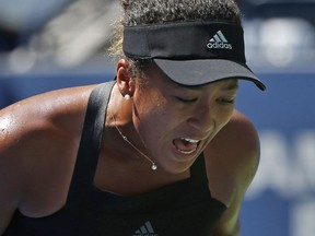 Naomi Osaka reacts after winning a point against Lesia Tsurenko during the quarterfinals of the U.S. Open, Wednesday, Sept. 5, 2018, in New York.