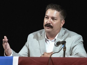 In this July 8, 2018, file photo, Randy Bryce, a Wisconsin Democratic candidate for the U.S. House, answers a question during a debate in Lake Geneva, Wis.