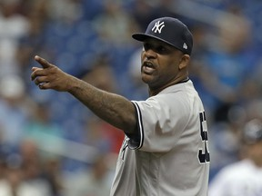 New York Yankees' CC Sabathia points at the Tampa Bay Rays dugout after he was ejected for hitting Tampa Bay Rays' Jesus Sucre with a pitch during the sixth inning of a baseball game Thursday, Sept. 27, 2018, in St. Petersburg, Fla.