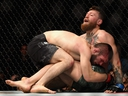 Khabib Nurmagomedov of Russia holds down Conor McGregor of Ireland in their UFC lightweight championship bout during the UFC 229 event inside T-Mobile Arena on Oct. 6, 2018 in Las Vegas, Nevada. (Harry How/Getty Images)