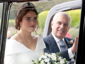 The bride Princess Eugenie of York with her father Prince Andrew, Duke of York arrives by car for her Royal wedding to Mr. Jack Brooksbank at St. George's Chapel on October 12, 2018 in Windsor, England.