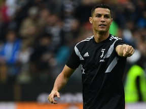 Juventus' Portuguese forward Cristiano Ronaldo gestures as he warms up before the Italian Serie A football match Udinese Calcio vs Juventus FC at the Dacia Arena stadium in Udine on Oct. 6, 2018. (Miguel MEDINA/AFP/Getty Images)