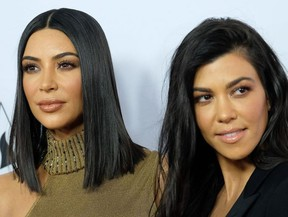 Kim Kardashian and Kourtney Kardashian attend the premiere of 'The Promise' at the Chinese theatre in Hollywood, on April 12, 2017.