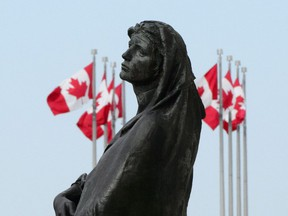 The statue of Veritas (Truth) is shown in front of the Supreme Court of Canada in Ottawa on Wednesday, May 23, 2018.