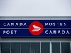 The Canada Post logo is seen on the outside the company's Pacific Processing Centre, in Richmond, B.C., on June 1, 2017. Canada's postal service is reporting a loss of nearly a quarter billion dollars in the second quarter of this year - and directly linking it to what it expects will be a massive payout to resolve a pay equity dispute with its biggest union. THE CANADIAN PRESS/Darryl Dyck
