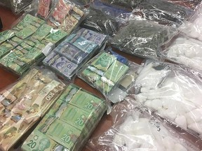 Various drugs, including meth, are displayed in Saskatoon after a bust was made in that city on May 31, 2018. (THE CANADIAN PRESS/HO-Saskatoon Police Service)
