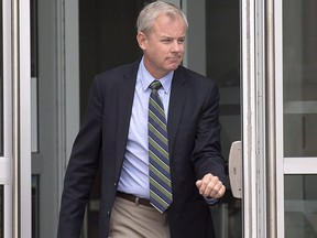 Dennis Oland heads from Court of Queen's Bench in Saint John, N.B. on Tuesday, Sept. 5, 2017 after a hearing to set a date for his new second-degree murder trial.