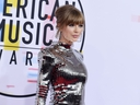 FILE - In this Oct. 9, 2018, file photo, Taylor Swift arrives at the American Music Awards at the Microsoft Theater in Los Angeles. Swift has donated $15,500 to a GoFundMe account of a fan whose family is struggling with medical bills.
