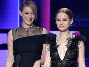 Lili Reinhart (L) and Madelaine Petsch walk onstage during the 2017 American Music Awards at Microsoft Theater on Nov. 19, 2017 in Los Angeles.