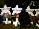 Stars of David with the names of those killed in a deadly shooting at the Tree of Life Synagogue stand in front of the synagogue in Pittsburgh, Sunday, Oct. 28, 2018.
