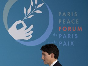 Prime Minister Justin Trudeau takes his seat for a session at the Paris Peace Forum in Paris, France, Sunday, November 11, 2018.