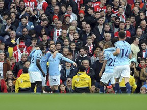 Manchester City's David Silva, second right, celebrates with teammates after scoring during English Premier League play against Southampton at Etihad stadium in Manchester, England, Sunday, Nov. 4, 2018.