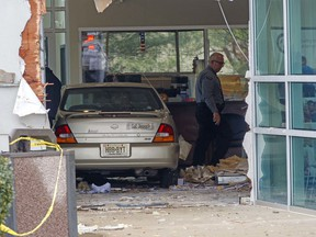 A car has crashed into a Social Security office, Tuesday, Nov. 13, 2018 in Egg Harbor, N.J.