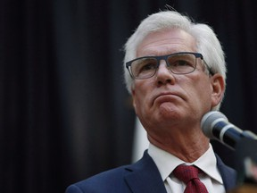 Jim Carr, Minister of International Trade Diversification, announces the federal government's action plan to tackle climate change during a press conference in Winnipeg on Oct. 23, 2018.