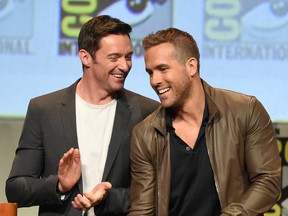 Hugh Jackman (L) and Ryan Reynolds appear onstage at the 20th Century FOX panel during Comic-Con International 2015 at the San Diego Convention Center on July 11, 2015 in San Diego, California.