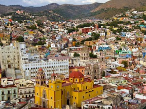 Guanajuato looks like colourful children's blocks strewn haphazardly at the bottom of a valley, spilling up the slopes surrounding it. (Postmedia file photo))