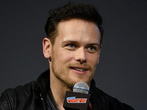 Sam Heughan speaks onstage during the Outlander panel during New York Comic Con at Jacob Javits Center on Oct. 6, 2018 in New York City.