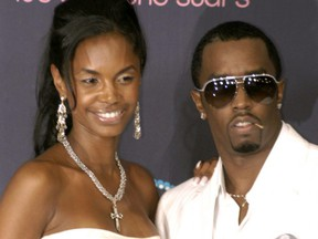Kim Porter and Sean Combs attend the BET Awards in Los Angeles on June 27, 2006.