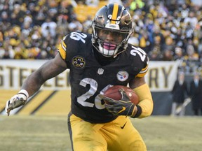 In this Jan. 14, 2018, file photo, Steelers running back Le'Veon Bell heads for the end zone after taking a pass from quarterback Ben Roethlisberger during NFL playoff action against the Jaguars, in Pittsburgh.