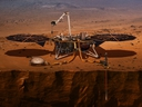 This illustration made available by NASA in 2018 shows the InSight lander drilling into the surface of Mars.