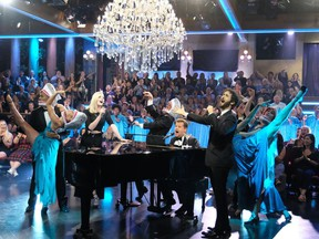 """This Sept. 26, 2018 image released by CBS shows Sophie Turner, left, and Josh Groban, right, performing """"Baby Shark"""" with host James Corden on """"The Late Late Show with James Corden,"""" in Los Angeles."""
