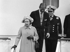 FILE - In this file photo dated Thursday, May 25, 1978, Britain's Queen Elizabeth II and Prince Philip leave the Royal Yacht Britannia for a stopover in Bremerhaven, on her state visit to West Germany. A newly discovered note dated 1995 in the U.K.'s National Archives Saturday Dec. 29, 2018, shows that Queen Elizabeth II let government officials know she would welcome a replacement for the Royal Yacht Britannia once it was decommissioned. The Royal Yacht Britannia was in service from 1954 to 1997.