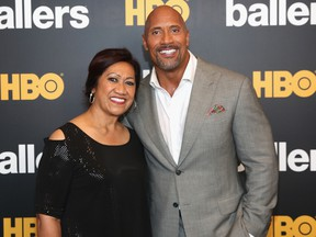 Ata Johnson (L) and Dwayne Johnson attend the HBO Ballers Season 2 Red Carpet Premiere and Reception on July 14, 2016 at New World Symphony in Miami Beach, Florida.