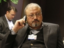 FILE - In this Jan. 29, 2011, file photo, Saudi Arabian journalist Jamal Khashoggi speaks on his cellphone at the World Economic Forum in Davos, Switzerland. Saudi Arabia issued an unusually strong rebuke of the U.S. Senate on Monday Dec. 17, 2018, rejecting a bipartisan resolution that put the blame for the killing of Saudi journalist Jamal Khashoggi squarely on the Saudi crown prince and describing it as interference in the kingdom's affairs.