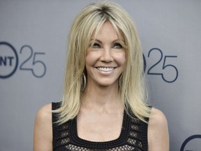 In a July 24, 2013 file photo, Heather Locklear arrives at the TNT 25th Anniversary Party at The Beverly Hilton Hotel in Los Angeles.
