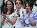 Kate, Duchess of Cambridge and Meghan, Duchess of Sussex, right, applaud during the women's singles final match between Serena Williams of the US and Angelique Kerber of Germany at the Wimbledon Tennis Championships, in London, Saturday July 14, 2018. (Andrew Couldridge, Pool via AP)