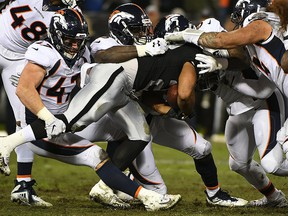Doug Martin of the Oakland Raiders rushes with the ball against the Denver Broncos during their NFL game at Oakland-Alameda County Coliseum on Dec. 24, 2018 in Oakland, Calif.