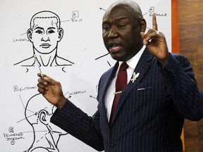 """Attorney Ben Crump discusses the results of a forensic examination on Emantic """"EJ"""" Bradford Jr., who was fatally shot by police in a shopping mall on Thanksgiving day, during a news conference in Birmingham, Ala., on Monday, Dec. 3, 2018.  (AP Photo/Jay Reeves)"""