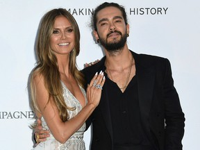 In this May 17, 2018, file photo, model Heidi Klum, left, and musician Tom Kaulitz pose for photographers upon arrival at the amfAR, Cinema Against AIDS, benefit at the Hotel du Cap-Eden-Roc, during the 71st international Cannes film festival, in Cap d'Antibes, southern France.