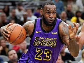 In this Dec. 7, 2018, file photo, Los Angeles Lakers' LeBron James drives against the San Antonio Spurs during the first half of an NBA game, in San Antonio.