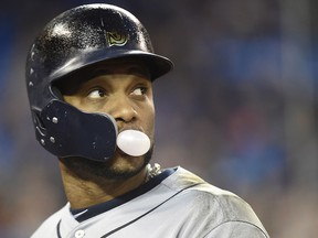Seattle Mariners' Robinson Cano blows a bubble as he looks towards the field after he lined out against the Blue Jays in Toronto on Wednesday May 9, 2018. (THE CANADIAN PRESS/Nathan Denette)