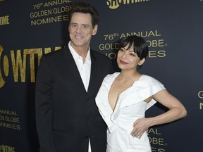 Jim Carrey, left, and Ginger Gonzaga attend the 2019 Showtime Golden Globe Nominees Celebration at Sunset Tower Hotel on Saturday, Jan. 5, 2019, in West Hollywood, Calif.