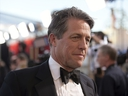 In this Sunday, Jan. 29, 2017 file photo, Hugh Grant arrives at the 23rd annual Screen Actors Guild Awards at the Shrine Auditorium & Expo Hall in Los Angeles.