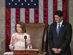 In this file photo from Tuesday, Jan. 3, 2017, House Democratic Leader Nancy Pelosi of California, left, joins Speaker of the House Paul Ryan, R-Wis., at the start of the 115th Congress, at the Capitol in Washington.