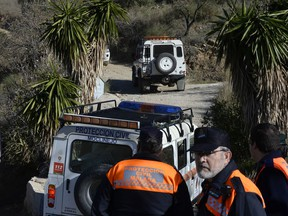 Emergency services look for a 2-year-old boy who fell into a well, in a mountainous area near the town of Totalan in Malaga, Spain, Monday, Jan. 14, 2019.