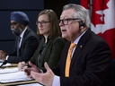Minister of Democratic Institutions Karina Gould, along with the Minister of Public Safety and Emergency Preparedness Ralph Goodale, and the Minister of National Defence Harjit Sajjan, make an announcement regarding safeguards to Canada's democracy and combating foreign interference during a press conference in Ottawa on Wednesday, Jan. 30, 2019.