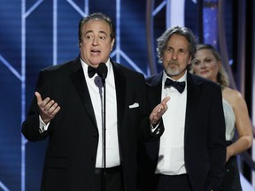 """FILE - In this Jan. 6, 2019 file image released by NBC, Nick Vallelonga accepts the award for best screenplay for """"Green Book"""" during the 76th annual Golden Globe Awards at the Beverly Hilton Hotel in Beverly Hills, Calif. Vallelonga apologized Thursday, Jan. 10 for a 2015 tweet about Muslims and 9/11 that has resurfaced. In the tweet, he said then-presidential-candidate Donald Trump was correct that television news on 9/11 showed Muslims in Jersey City cheering and he had seen it. There's no evidence such celebrations occurred."""