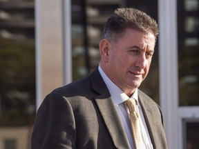 Former gymnastics coach Dave Brubaker leaves the court house in Sarnia, Ont., Tuesday, October 23, 2018 following the first day of testimony in his sexual assault trial. Elizabeth Brubaker was provisionally suspended as a coach by Gymnasitics Canada on Monday, following a number of written complaints to the national governing body about her conduct. Her husband Dave Brubaker, who was the director of the women's national gymnastics team, has pleaded not guilty to one count of sexual assault and one count of sexual exploitation in an ongoing criminal trial.