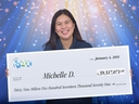 Michelle De Roma from Surrey, B.C. claims her Lotto Max prize of $39.5 million in Vancouver, Friday, Jan. 4, 2019.