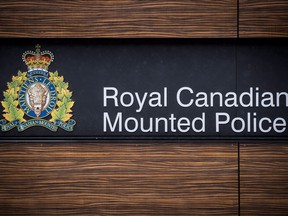 """The RCMP logo is seen outside Royal Canadian Mounted Police """"E"""" Division Headquarters, in Surrey, B.C., on Friday April 13, 2018. Nova Scotia's police watchdog says an RCMP constable has been charged with sexual assault and voyeurism after an alleged incident at a party."""
