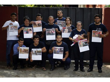 In this Jan. 12, 2019 photo, the firefighters of San Roque Gonzalez pose for a group photo before going out in the streets to sell calendars, in Asuncion, Paraguay.
