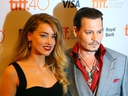 Johnny Depp with his wife Amber Heard on the red carpet for movie